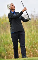 Janina Jacobs of St. Clair watches her shot off the No. 7 tee during the 2019 contest at Whispering Willows.