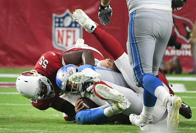 Lions quarterback Matthew Stafford is sacked by Cardinals' Chandler Jones late in the overtime period.