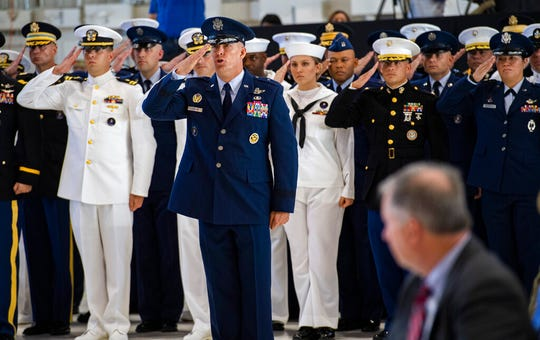 U.S. Space Command Chief of Staff, Brig. Gen. Brook Leonard, and the rest of his staff give their first salute to Commander Gen. John W. Raymond Monday, Sept. 9, 2019, during a ceremony to recognize the establishment of the United States Space Command at Peterson Air Force Base in Colorado Springs, Colo.