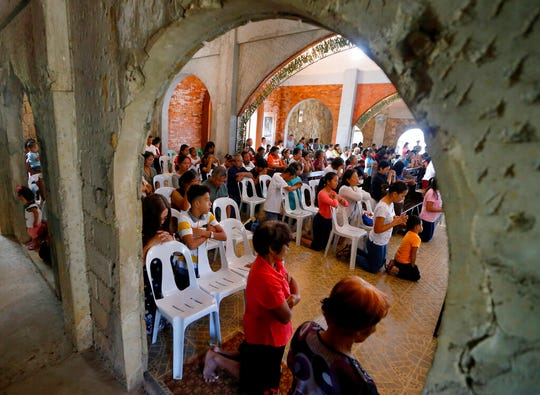 In this Jan. 27, 2019 photo, worshippers attend a Sunday Mass officiated by a substitute priest in the chapel built by U.S. priest Father Pius Hendricks in the village of Talustusan on Biliran Island in the central Philippines. Parishioners said Hendricks would ask children to occupy benches in front of the altar while saying Mass.