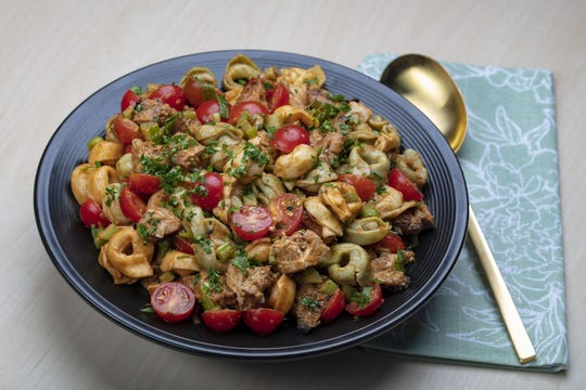 Chicken, tomatoes and tortellini make up this salad tossed with a tomato vinaigrette. (Brian Cassella/Chicago Tribune/TNS)