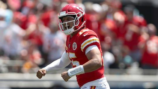 Kansas City Chiefs quarterback Patrick Mahomes (15) celebrates after a touchdown pass Sunday. The Chiefs defeated the Jaguars 40-26.