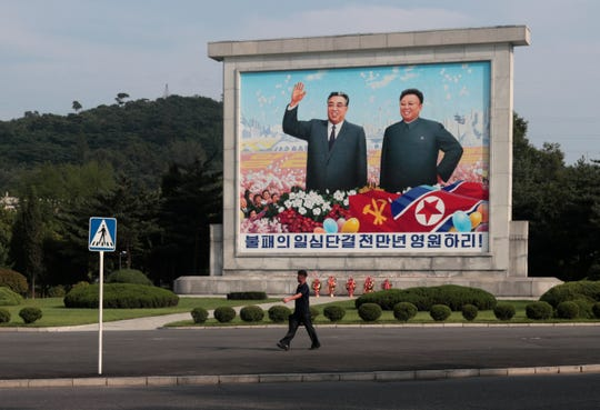 A large mural of late North Korean leaders Kim Il Sung, and his son Kim Jong Il in Pyongyang, North Korea, Monday, Sept. 9, 2019.