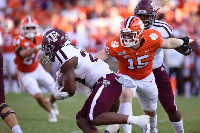 Clemson's Jake Venables, the son of the defensive coordinator, tackles Texas A&M running back Isaiah Spiller in the second half Saturday.