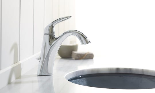 If you have a three-hole sink with the outside holes 4 inches apart, you should be able to install a single-handle bathroom faucet.  (Kohler)