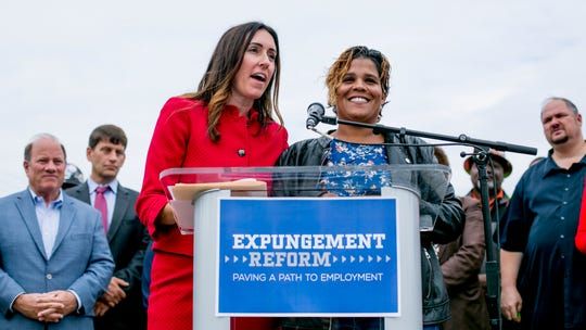 Project Clean Slate Attorney Stephani LaBelle, left, and her client Tamika Mallory speak at a press conference Monday on the east side of Detroit to announce a new bill speeding up expungement of the criminal records of low risk offenders.