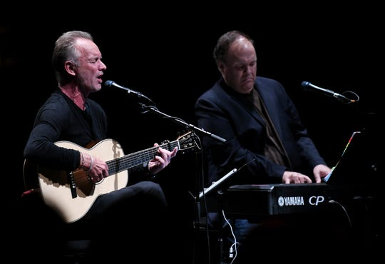 """British musician Sting performs a private concert with keyboardist Rob Mathes, right, playing some of the songs from his musical """"The Last Ship"""" at the Detroit Opera House in Detroit on Sept. 9, 2019. The musical will come to the Detroit Opera House in the spring."""