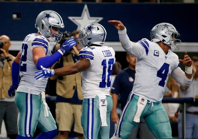 Dallas Cowboys' Jason Witten (82), Randall Cobb (18) and Dak Prescott (4) celebrate a touchdown catch by Witten in the first half.