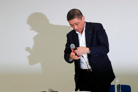 Nissan Chief Executive Hiroto Saikawa prepares to leave a press conference in the automaker's headquarters in Yokohama, near Tokyo, Monday, Sept. 9, 2019.