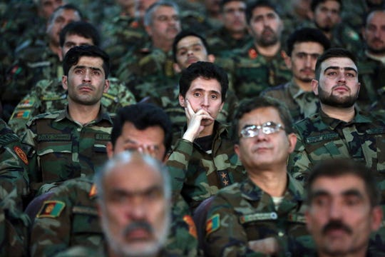 "Afghan army soldiers listen to a speech by President Ashraf Ghani during a ceremony to introduce the new chief of the intelligence service, in Kabul, Afghanistan, Monday, Sept. 9, 2019. Ghani, whose government was sidelined in the U.S.-Taliban talks, again declared that his country was ready to meet with the Taliban but that ""negotiation without a cease-fire is not possible."""