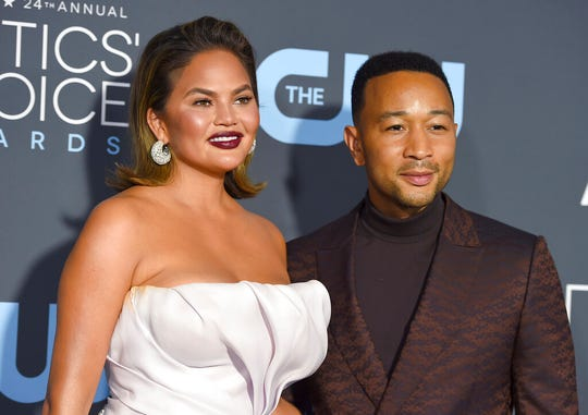 """In this Jan. 13, 2019 file photo, Chrissy Teigen, left, and John Legend arrive at the 24th annual Critics' Choice Awards in Santa Monica, Calif. President Donald Trump targeted the couple following an MSNBC special on criminal justice reform which Legend appeared on. In a series of tweets late Sunday, Sept. 8 and early Monday, Sept. 9 Trump felt he wasn't getting credit for a law he signed in late December that, among other things, reduces mandatory minimum sentences in some cases. Trump called Legend """"boring"""" and said Teigen was """"filthy mouthed."""" He criticized them for not playing a role in the reform."""