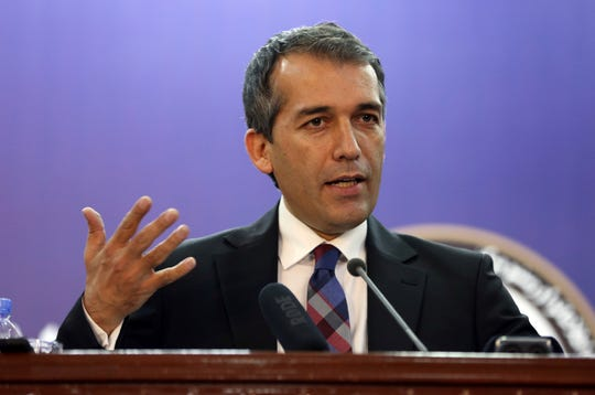 Afghan Presidential Spokesman Sediq Seddqi gives a press conference in Kabul, Afghanistan, Sunday, hours after U.S. President Donald Trump in a series of tweets announced that he had canceled a secret meeting set for Sunday at Camp David with Taliban and Afghan leaders.