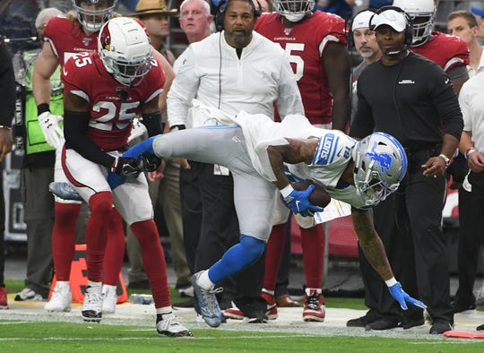 Cardinals' Chris Jones prevents Lions wide receiver Kenny Golladay from getting the first down at the end of  the fourth quarter.