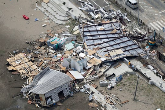 Beach houses are damaged as typhoon hits the beacfront area in Miura, south of Tokyo, Monday, Sept. 9, 2019.