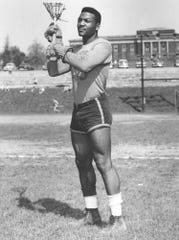 Jim Brown is shown playing in his last college lacrosse game for Syracuse University in this 1957 handout from Syracuse University.