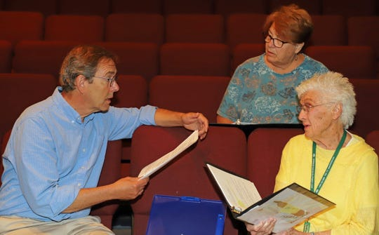 "For ""Every Brilliant Thing,"" Thomas Putnam, left, is assisted by Barbara Biddison, right, and Stage Manager Linda Iseri."