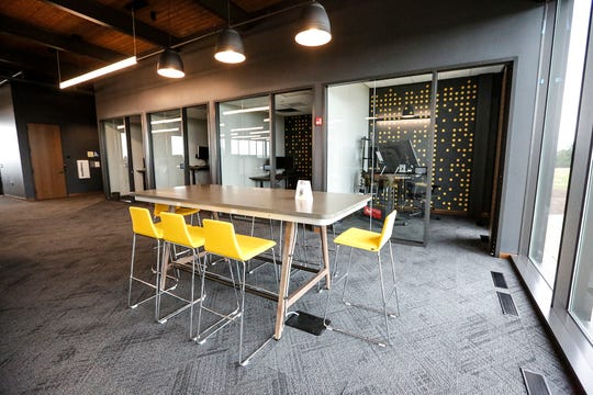 Company colors of black and grey with accents of yellow decorate rooms Wednesday, Sept. 4, 2019 at the new CD Smith Construction headquarters at 125 Camelot Drive in Fond du Lac, Wis.