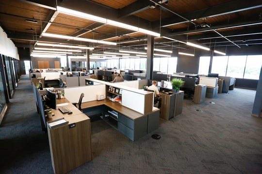 A large open office space with natural lighting Wednesday, Sept. 4, 2019 at the new C.D. Smith Construction headquarters at 125 Camelot Drive in Fond du Lac, Wis.
