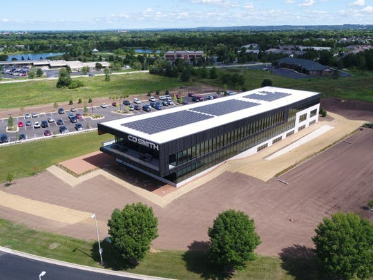 Solar panels cover the roof of the new C.D. Smith Construction headquarters, reducing a portion of the building's energy usage.