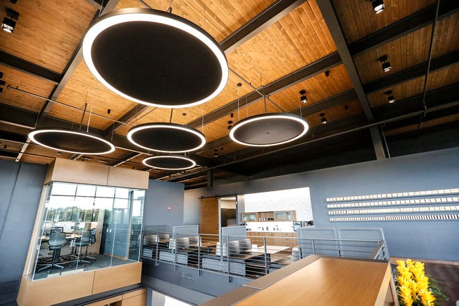 Modern lighting decorates rooms Wednesday, Sept. 4, 2019 at the new C.D. Smith Construction headquarters at 125 Camelot Drive in Fond du Lac, Wis.