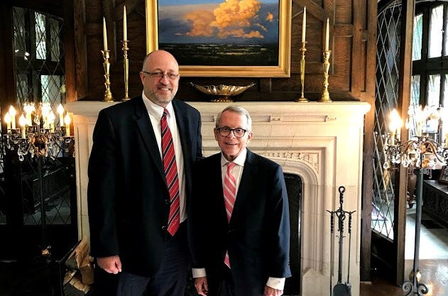 Gary Click, left, resigned his position as the chairman of the Governor's Evangelical Advisory Council on Sept. 3. He stands with Gov.  Mike DeWine.
