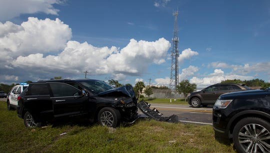 An SUV smashed into the rear of a transport vehicle carrying 13 prisoners to the Lee County Jail Monday with three of them injured.