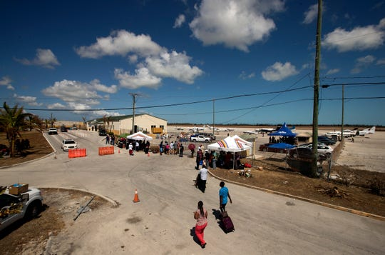 More than 100 people look for supplies outside the gates of the Grand Bahama International Airport in Freeport, Bahamas on Monday.  A Hurricane Dorian relief mission on Monday from Fort Myers to the Bahamas — included three planes carrying more than 3900 pounds of supplies that were donated by the Southwest Florida community.
