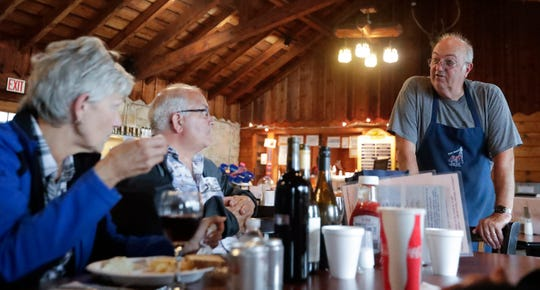 Judy Goodchiod, left, and her husband, Greg, talk to Leigh Stegemann during the fish fry Friday, Sept. 6, 2019, at Point Beach State Forest concession stand that serves about 100 plates in Two Rivers, Wis. Ebony Cox/USA TODAY NETWORK-Wisconsin