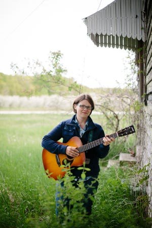 "Door County-based folk musician Katie Dahl says her fourth solo album, ""Wildwood,"" has more of a rock 'n' roll vibe than her previous recordings thanks to working with producer JT Nero."