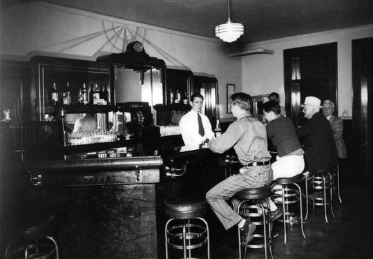 Customers sit at the bar of the Union Hotel & Restaurant in De Pere, in a historic photo of the facility, which first opened in the 1800s.