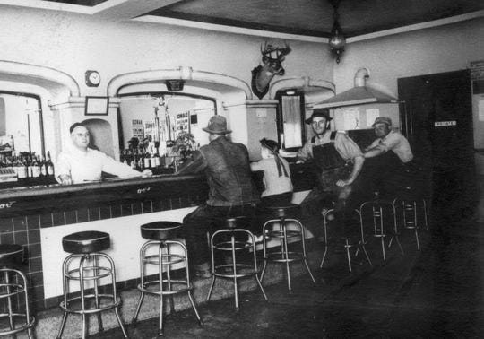 Customers sit at the bar of Suster's Arcade in an undated photo that hangs on the wall of the Denmark restaurant that got its start in 1909.