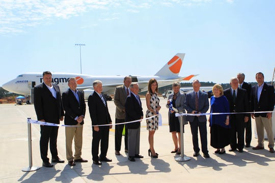 Lt. Gov. Pamela Evette and GSP Airport Commissioner Minor Shaw cut the ribon to celebrate the opening of a new $33 million 110,000 square foot commercial cargo facility, on Monday, Sept. 9, 2019. This expansion promises to increase air-freight business that has already more than doubled since 2008.