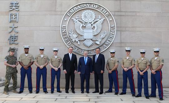 U.S. Marines stand with Sen. David Perdue , left, U.S. Ambassador to China Terry Branstad, center, and Sen. Steve Daines at the U.S. Embassy in Beijing.