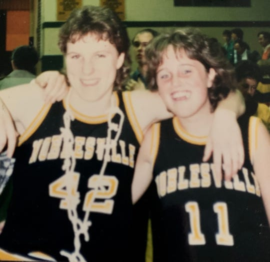 Krissi Davis (left) shown with teammate and friend Jill Almodovar as Noblesville high basketball players.