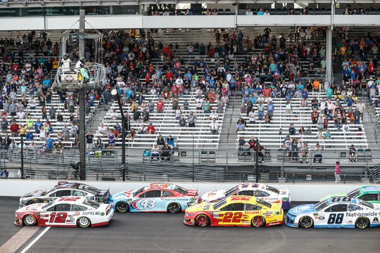 Cars group up for a green flag after a crash caused a caution during 2019 Big Machine Vodka 400 at the Brickyard at Indianapolis Motor Speedway on Sunday, Sept. 8, 2019.