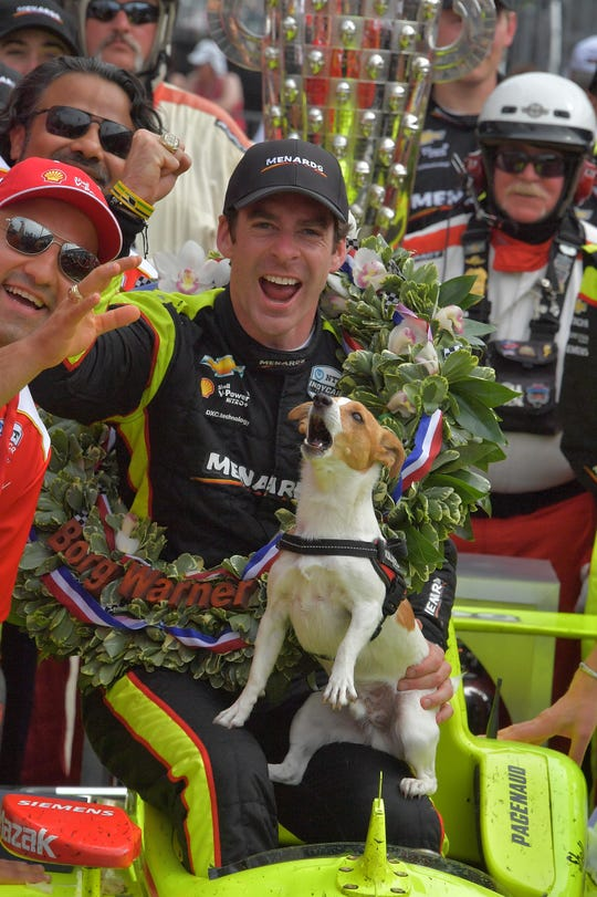 Simon Pagenaud and his dog, Norman, in victory lane after winning the 2019 Indianapolis 500.