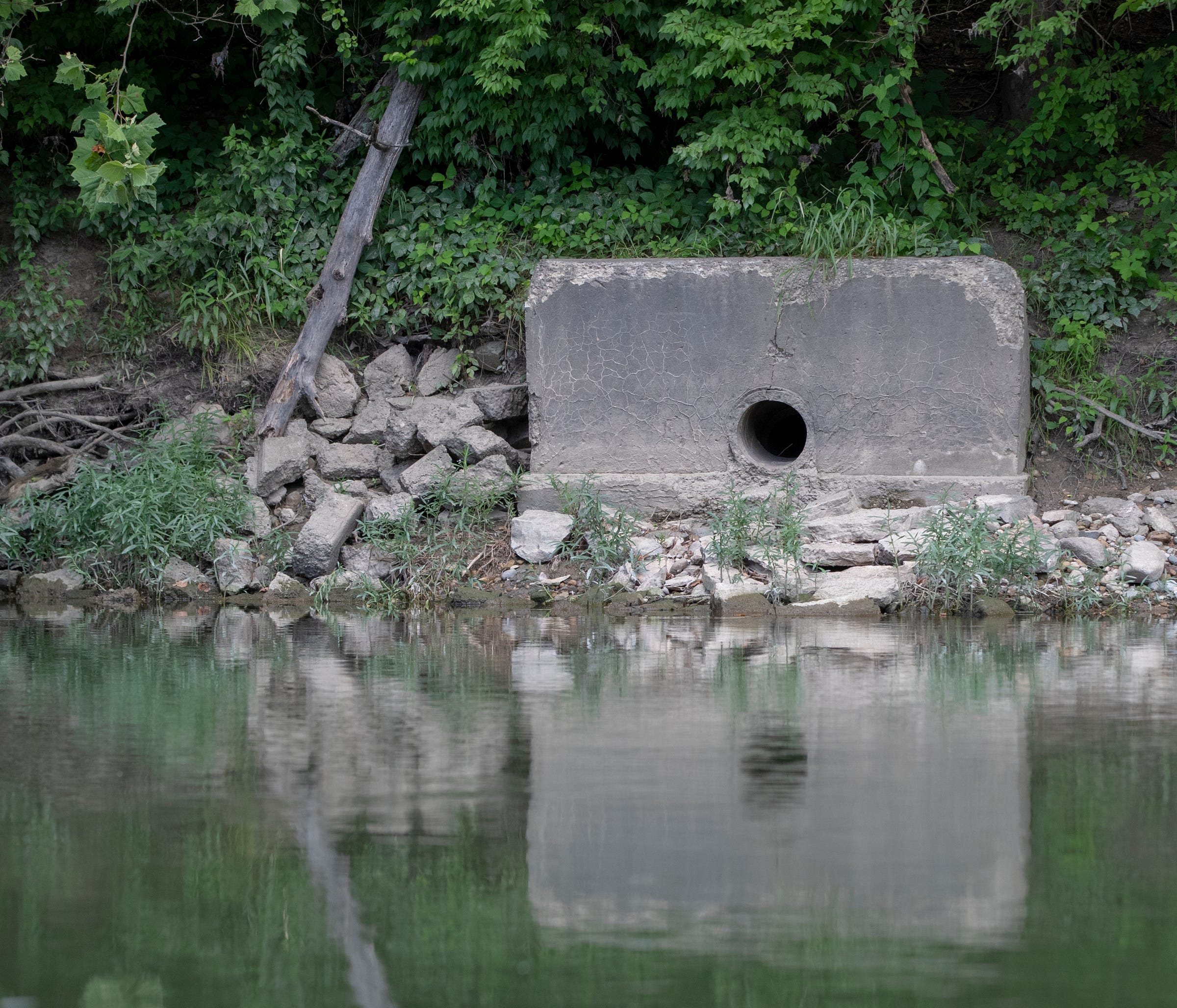 A combined sewer overflow pipe along the White River that can contain raw sewage or stormwater runoff, which brings a myriad of pollutants into local waterways in Indianapolis, as seen on Thursday, July 11, 2019.