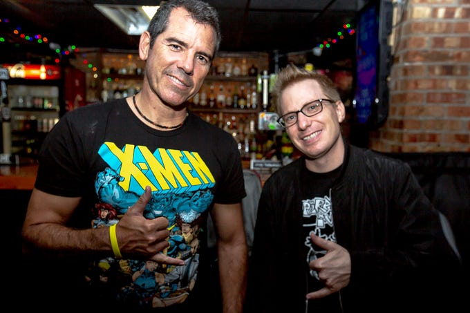 """Graham Elwood, left, and Ron Placone pose for a photo after performing their stand up comedy sets during the """"Progressive Comedy Tour,"""" Sunday, Sept. 8, 2019, at the Yacht Club in Iowa City, Iowa."""