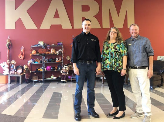 Evan Crass, KARM's director of partner engagement, pictured left with Stacy Loy, director of operations, and Keith Lamb, retail manager, at the Mountain Grove KARM store grand opening on Sept. 6, 2019.