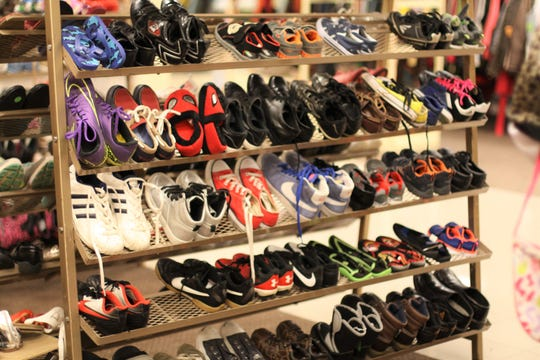 The children's shoe department is arranged by size and features many popular brands at South Knoxville's KARM Store.