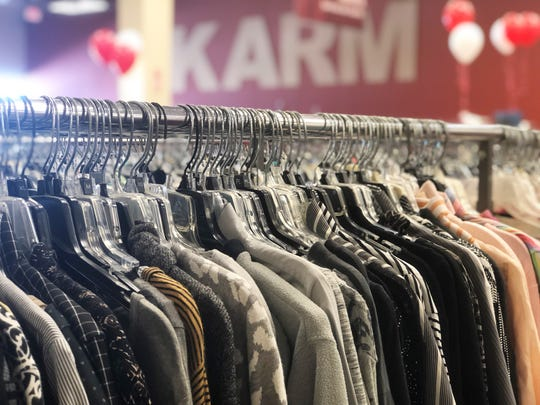 Donations are closely inspected in the processing center at the KARM Mountain Grove store, before they are priced and arranged by size and color on the shop floor. The racks feature many boutique brands in next-to-new and new with tags condition.