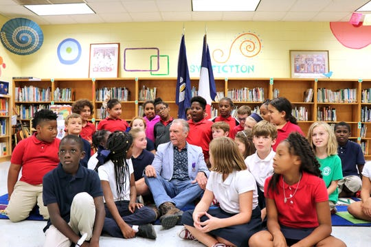 Francophone musician Zachary Richard speaks with fourth-graders of Myrtle Place Elementary, a French immersion school in Lafayette, during a ceremony in which Richard received a national order Monday, Sept. 9, 2019.