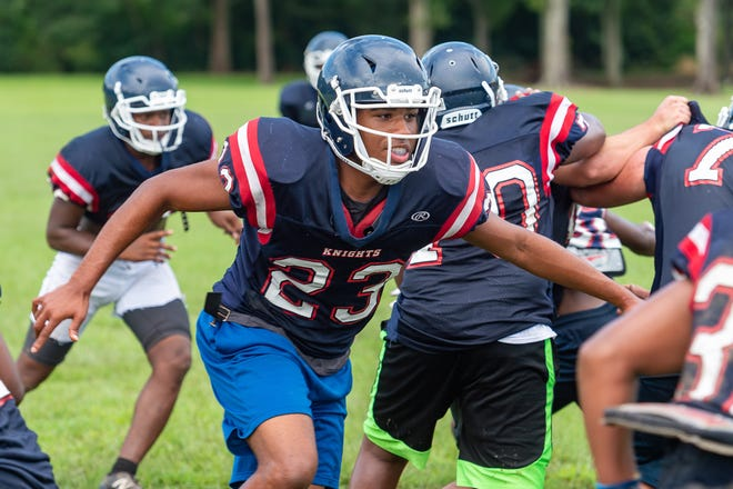 LCA senior defensive end Tim Cotton is shown at summer practice Aug. 27.