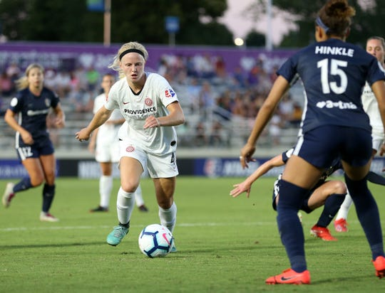 Hartland graduate Maddie Pogarch controls the ball for the Portland Thorns in a game against the North Carolina Courage on June 15, 2019.
