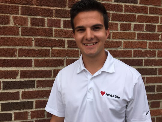 Brighton High School student Adrian Kozakov wants to raise at least $10,000 with an hour-long police escorted car rally through Brighton and Milford. He will donate the money to charity Fund A Life.