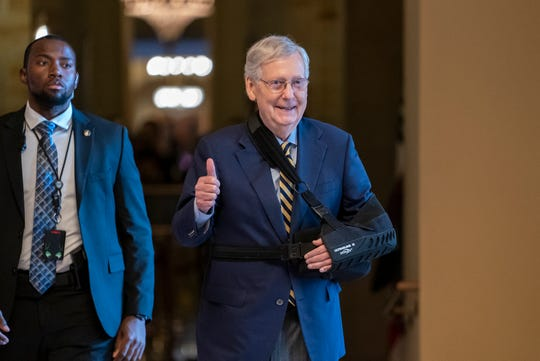 Senate Majority Leader Mitch McConnell, R-Ky., walks to the Senate chamber with his arm in a sling after he suffered a broken shoulder in a fall at his home during the August recess, at the Capitol in Washington, Monday, Sept. 9, 2019. Congress returns today for the fall session with pressure mounting on McConnell to address gun violence, election security and other issues. (AP Photo/J. Scott Applewhite)