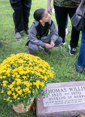 Dante Burrell, 9, finds out about his ancestors and meets a number of new family members for the first time at dedication of Thomas and Merry Willis' markers, at Maple Grove Cemetery, Mason, Michigan, Sunday, Sept. 8, 2019.