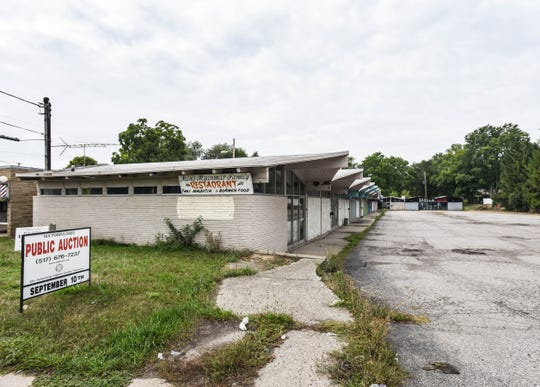 The site of Naing Myanmar Family Restaurant on S. Cedar Street in Lansing.  The entire strip mall will be auctioned Sept. 10 due to tax foreclosure.