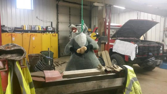 A photo taken by a City of Grand Ledge employee in April of 2017 shows a large stuffed toy raccoon hanging from a noose in a city maintenance garage.