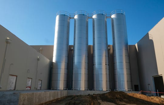 Several of the giant silos are already in place at the Glanbia cheese factory Thursday, Sept. 5, 2019. The plant is expected to open for production in the fall of 2020.